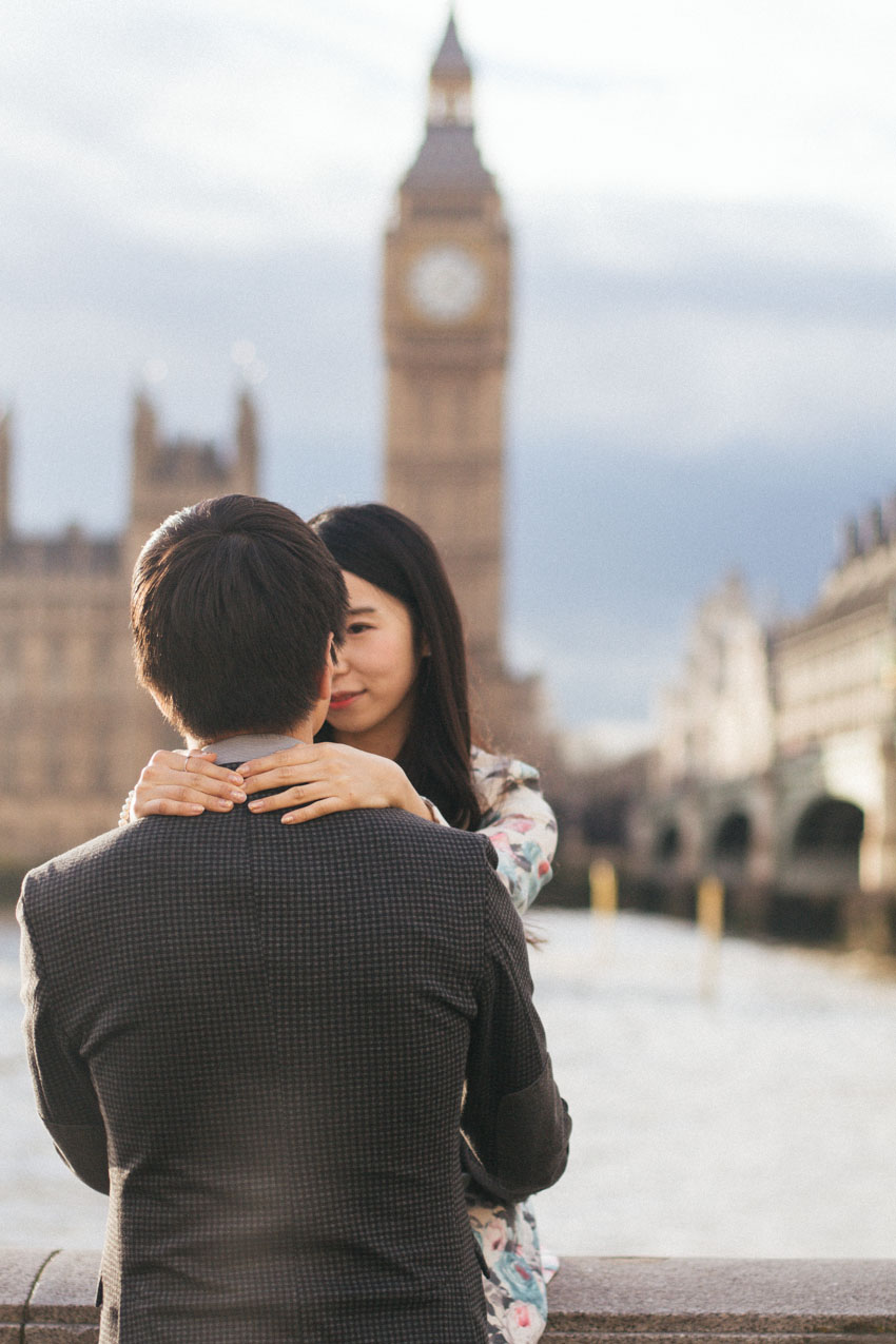 korean couple in front of river thames
