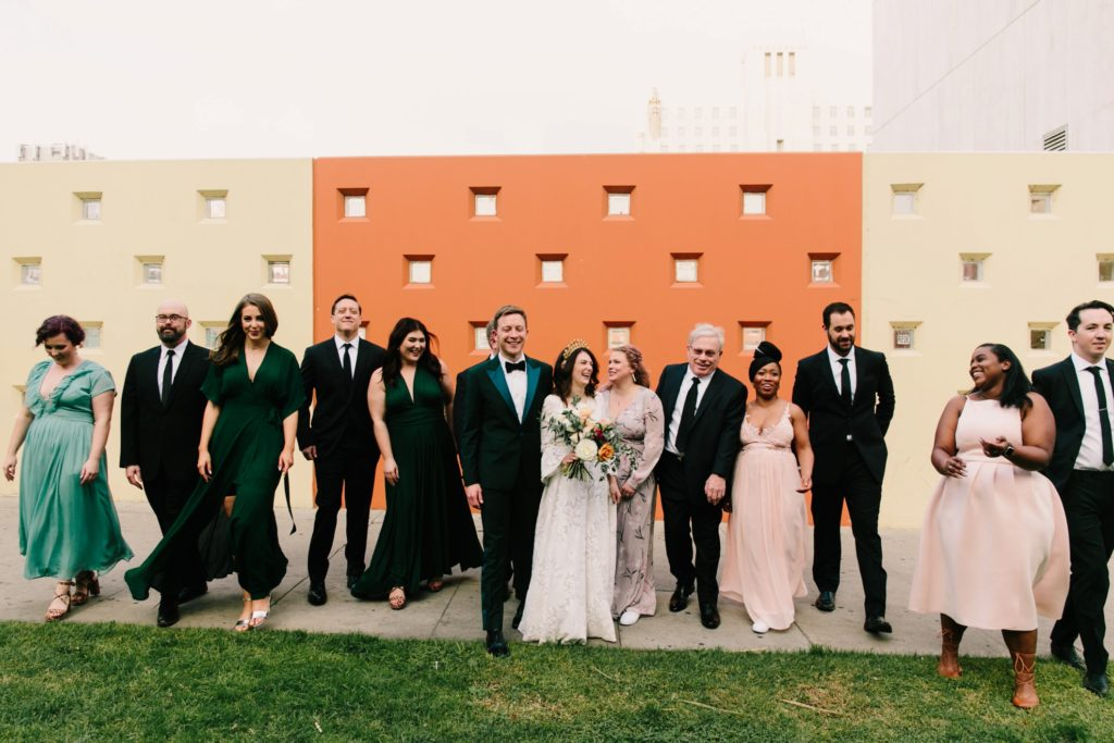 bridal party photos in front of colorful wall in koreatown los angeles